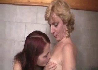 Redhead and her mature mother in the shower