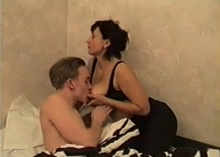 Mature soothes her son with pussy and tits