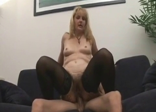 Mature in stockings enjoys hairy anal sex