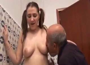 Pigtailed daughter and father in the shower