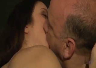 Beautiful daughter and her old father kissing