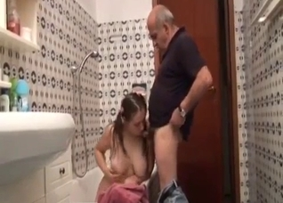Tall daughter bends to suck dad's rod