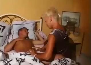 Mom sucking sleeping son's boner