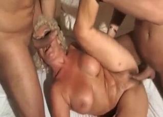 Naughty granny handles two cocks