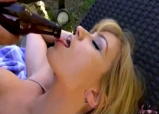 Beer bottle used as a dildo during a picnic