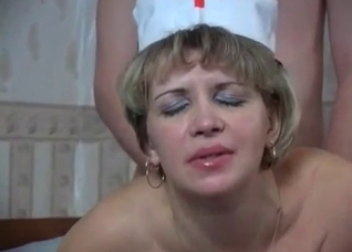 Mature mom in stockings role playing a nurse
